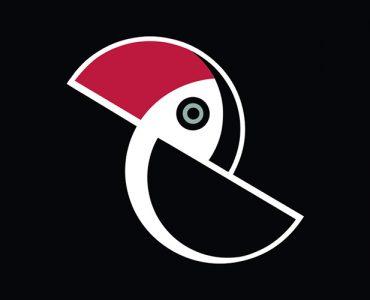 Logo PPA - czarno-biała stylizowana sylwetka tukana z czerwonym dziobem
